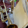 Stock Photo: 2 trumpets and folder of sheet music