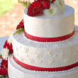 Wedding cake with red stripes and flowers — Stock Photo
