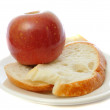 Apple with bread on plate — Stock Photo