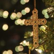 Cross ornament on christmas tree — Stock Photo