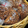 Stock Photo: Hazelnut Filberts packaged inside of clear bags in gift basket