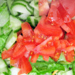 Red Tomatos on green salad — Stock Photo #4627408
