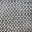 Cement Grid Indent On Asphalt — Stock Photo