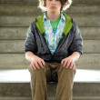 Youth sits on steps — Stock Photo #4629607