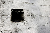 Square hole in wall — Stock Photo
