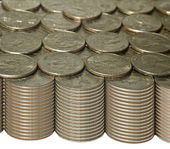 Stacks of quarters with golden tones — Stock Photo