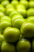 Green Apples Piled up at Supermarket — Stock Photo