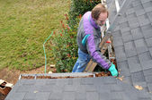Man cleaning gutters — Photo
