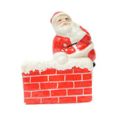 Santa Claus resting on a chimney — Stockfoto