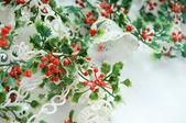 Plastic Holly berries garland — Stock Photo