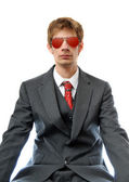 Young business man with red aviators — Photo