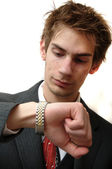 Attractive Young businessman in suit checks his golden wrist watch for the — Stock Photo