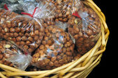 Hazelnut Filberts packaged inside of clear bags in gift basket — Stock Photo