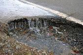 Water corroding asphalt street road — Stock Photo