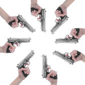 Guns pointing towards center — Stock Photo