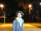 Youth in night street — Stockfoto