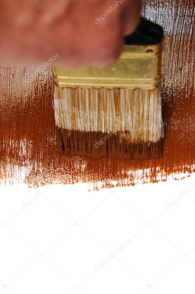 Wet brown paint being painting on a whire surface with a paint brush. — Stock Photo #4624445