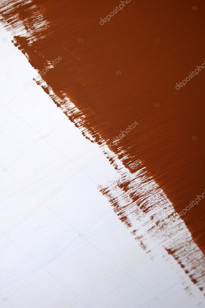 Wet brown paint being painting on a white surface with a roller. — Stock Photo #4624447