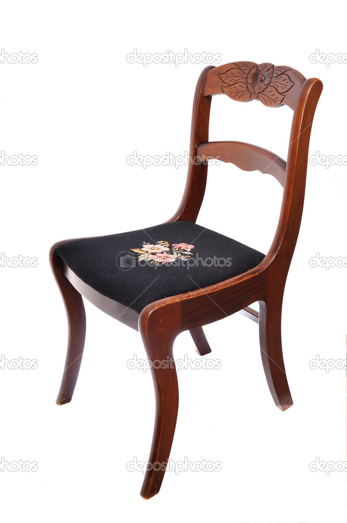 Brown chair isolated on white with flower design on seat — Stock Photo #4625966
