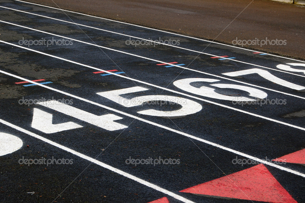 Numbered lanes on a mile running fitness athletic black track. — Stock Photo #4629667