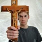 Holding up Crucifix — Stock Photo #4630608