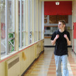 Royalty-Free Stock Photo: Student walking in hallway