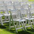 Stock Photo: Empty chairs on yard grass