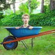 Stock Photo: Wheelbarrow with man inside
