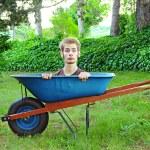 Wheelbarrow with man inside — Stock Photo