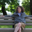 Teenager sits on bench and relaxes while thinking — Stock Photo #4637495