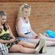 Teenage girls texting with mobile cellphones — Stock Photo