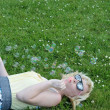 Girl Blowing Bubbles in Grass — Stock Photo