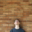 Young man looks up above — Stock Photo