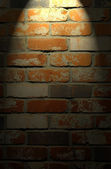Brick wall with spotlight — Stock fotografie