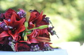 Red Bouquet of Flowers on Table — Stock Photo