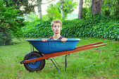 Wheelbarrow with man inside — Stock Photo