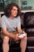 Playing video games on the couch — Stock Photo