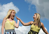 Young happy girls highfive — Stock Photo