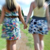 Two girls Holding Hands — Stock Photo