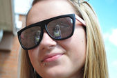 Girl in Her sunglasses Reflection — Stock Photo