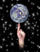 Balancing Earth on finger — Stock Photo