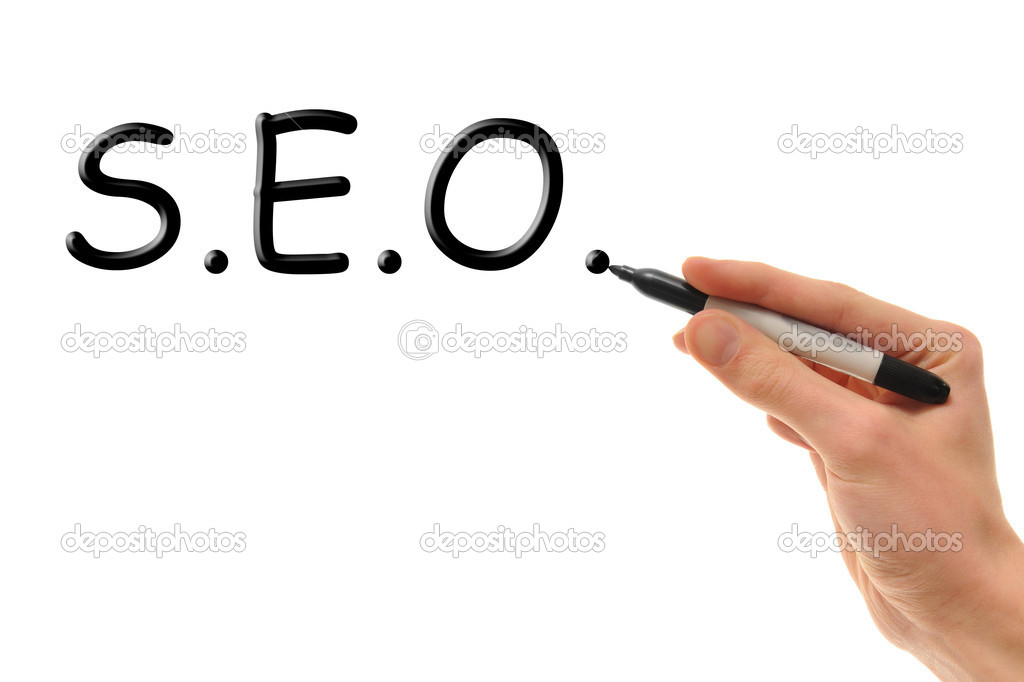 A white Caucasian hand writes the word S.E.O. on a white board with his marker. — Stock Photo #4630174