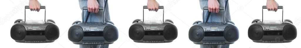 Hand holding a boombox isolated on white background.  Stock Photo #4630868