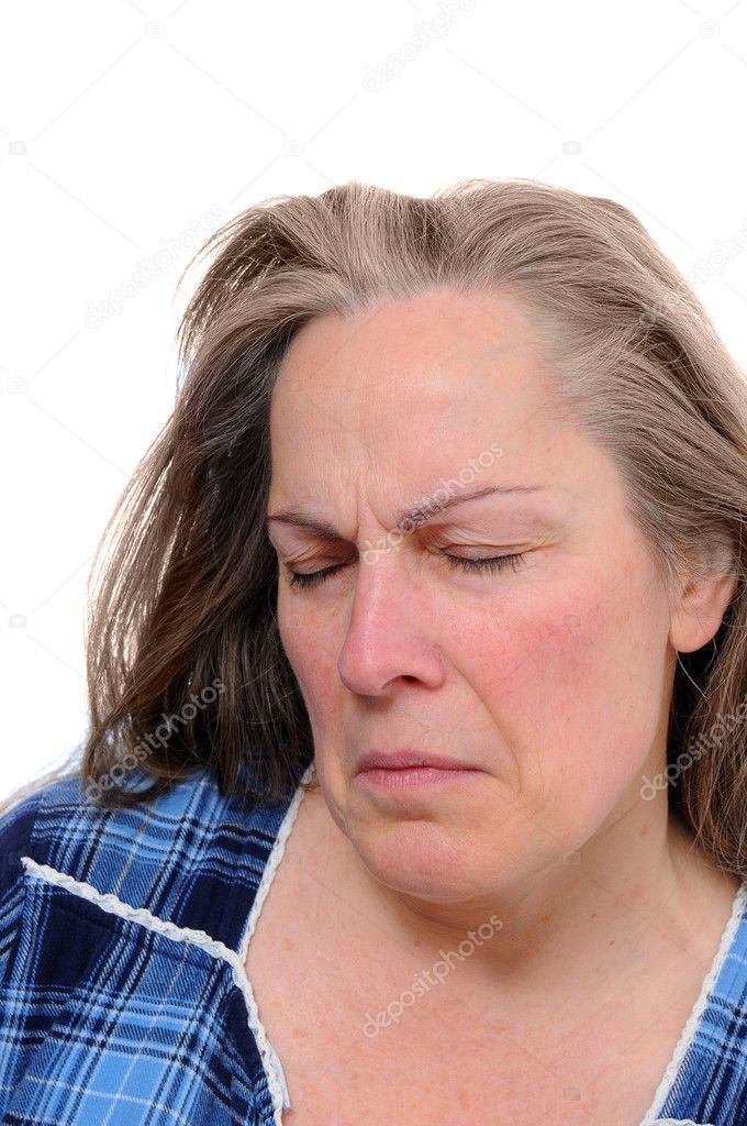 Middle aged woman with with a bitter frown isolated on white — Stock Photo #4631279