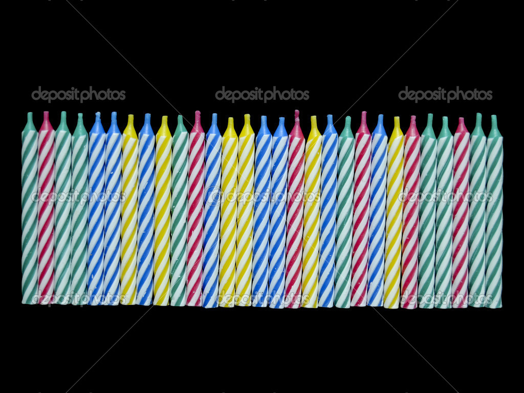 A bunch of unlit new birthday candles isolated on black background — Stock Photo #4638272