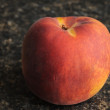 Stock Photo: Peach on Countertop