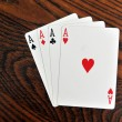 Four Aces - Playing Cards on Wooden Table — Stock Photo