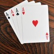 Four Aces - Playing Cards on Wooden Table — Stock Photo #4646701