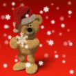 Royalty-Free Stock Photo: Teddy Bear with Santa\'s cap and snowflake