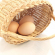 Basket and eggs — Stock Photo